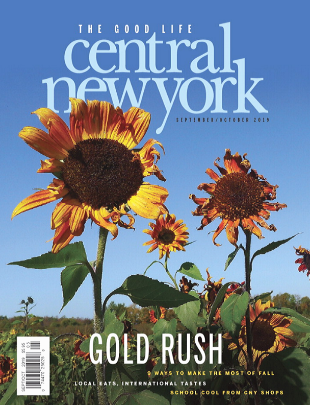 Central New York Magazine September October 2019 cover with sunflowers against a blue sky