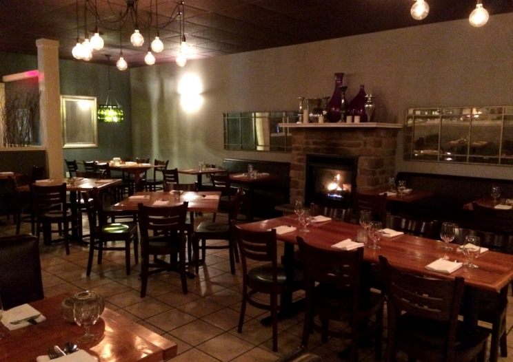 dining area at Moro's Table Central New York restaurant with fireplace