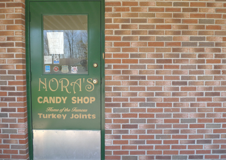 door of nora's candy shop home of CNY regional dish turkey joints