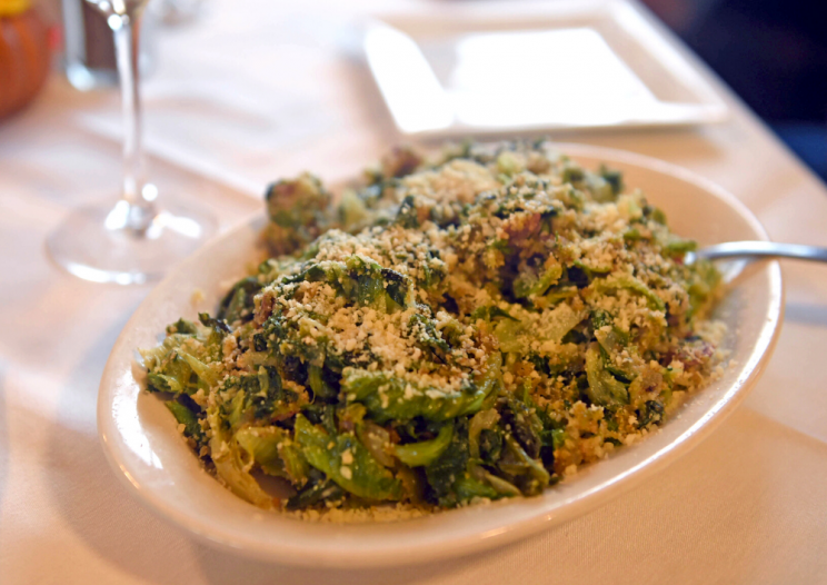 plate of utica greens a CNY regional dish