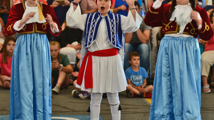 dancers at Greek festival in traditional costumes