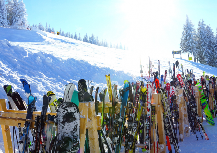 skis and snowboards lined up