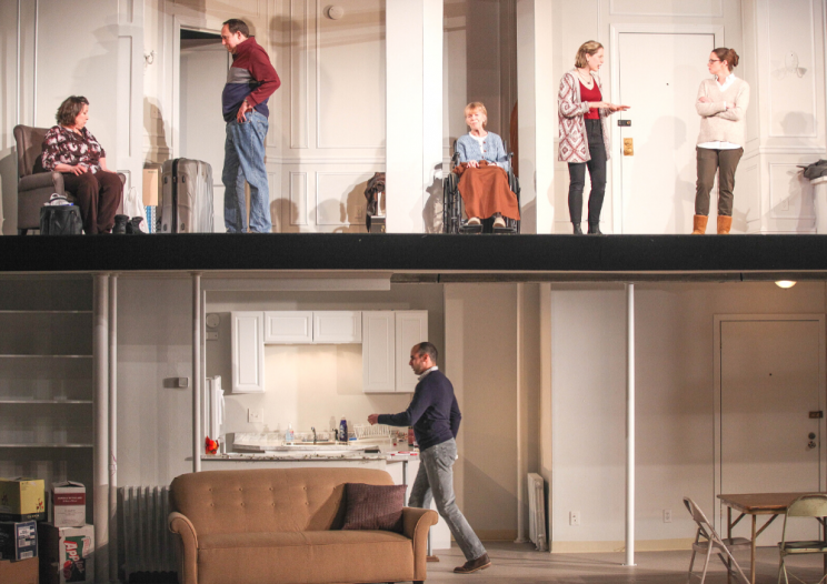 actors on a two-level stage set