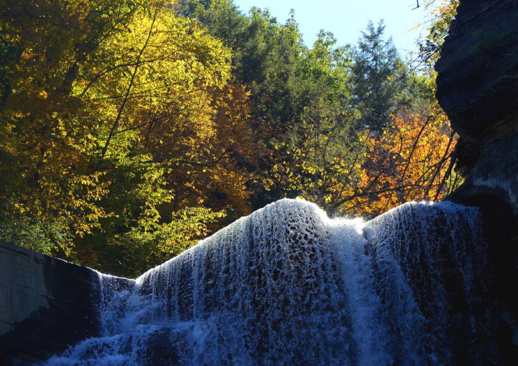 The top of Taughannock Falls withfall foliage in the background