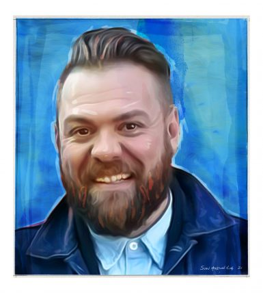 White man in his 30s with a beard and a blue jacket