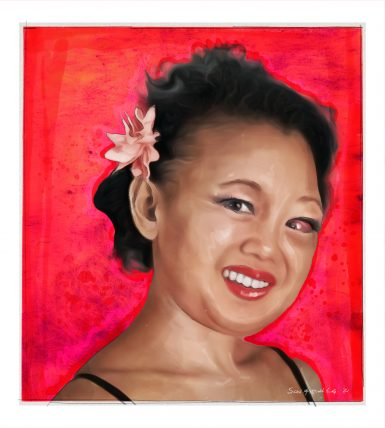 A Japanese American woman in her 30s with a facial deformity wears a flower in her hair