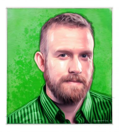 White man in his 30s with a short beard and green shirt