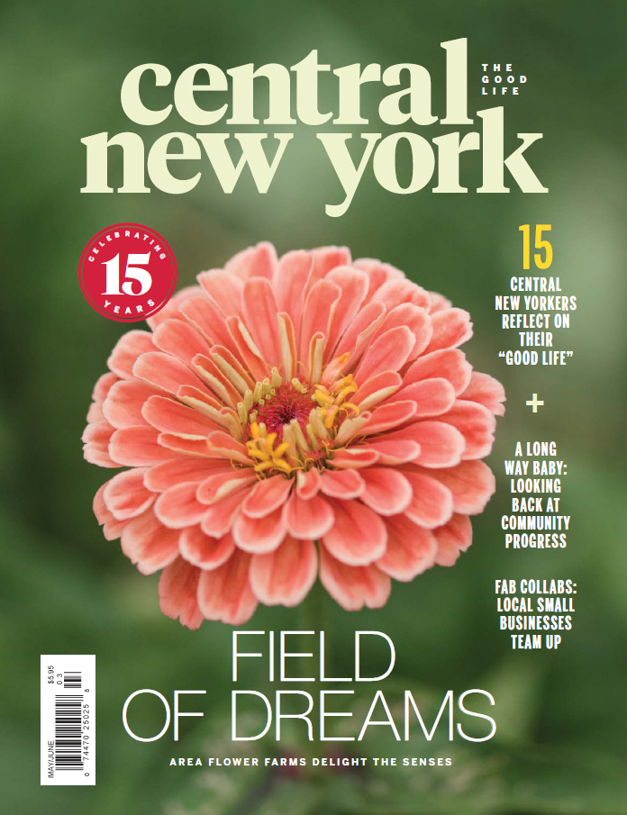 Magazine cover with Central New York Magazine at the top and a large pink zinnia bloom in the center